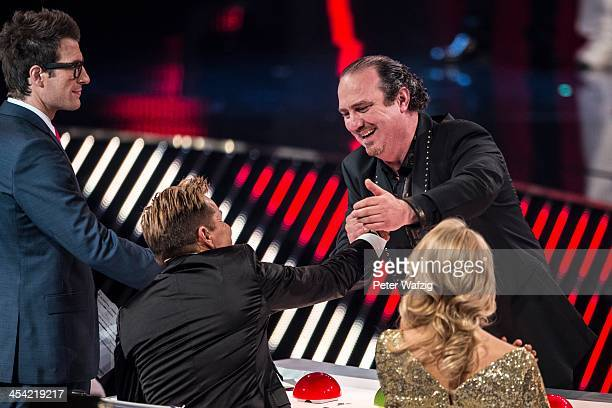 Host Daniel Hartwich jury member Dieter Bohlen and Fortunato Lacovara shake hands after entering the finals during the second Semifinal of 'Das...
