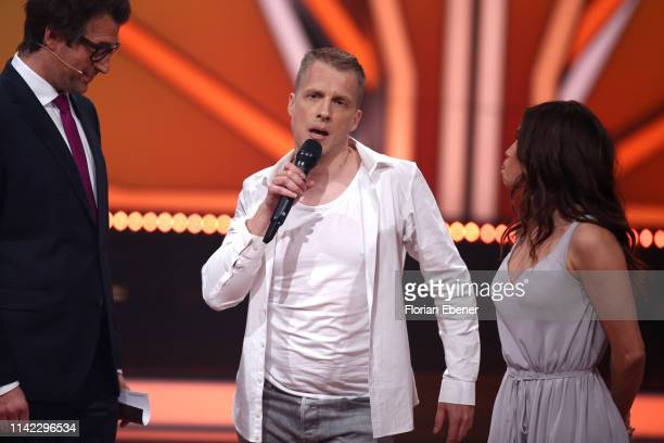 Host Daniel Hartwich Oliver Pocher and Christina Luft speak on stage during the 4th show of the 12th season of the television competition Let's Dance...