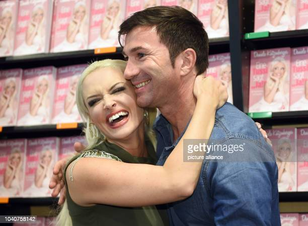 TV host Daniela Katzenberger and her husband Lucas Cordalis posing during a photo call for the presentation of her new book 'Eine Tussi sagt Ja' in...
