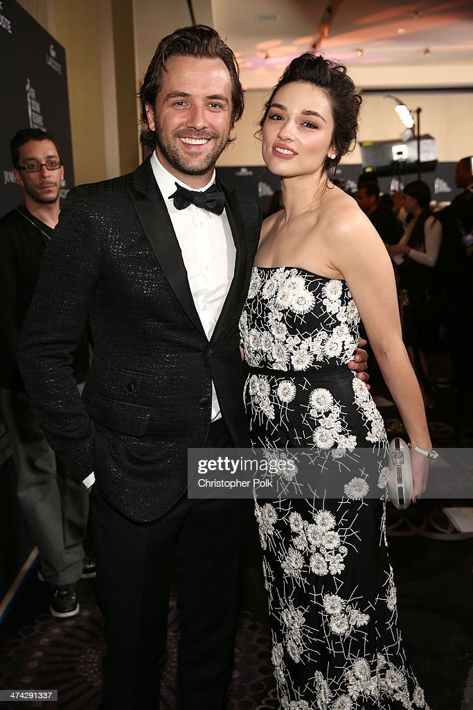 TV host Darren McMullen (L) and actress Crystal Reed attend the 16th Costume Designers Guild Awards with presenting sponsor Lacoste at The Beverly Hilton Hotel on February 22, 2014 in Beverly Hills, California.
