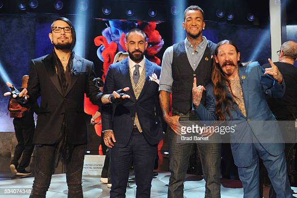 Host Dave Navarro judge Chris Nunez tattoo artist Anthony Michaels and judge Oliver Peck pose on stage after the 'Ink Master' season 7 LIVE finale on...