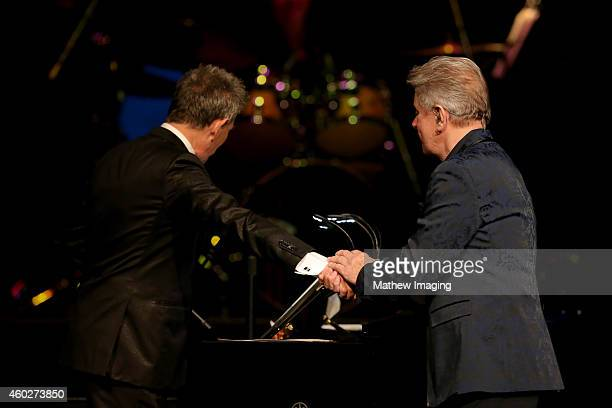 Host David Foster and singer/songwriter Peter Cetera perform onstage at a PBS SoCal Holiday Celebration with David Foster and Friends at Dolby...