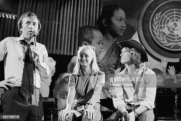 Host David Frost and singers Olivia Newton-John and Andy Gibb , at 'The Music for UNICEF Concert: A Gift of Song' benefit concert held at the United...