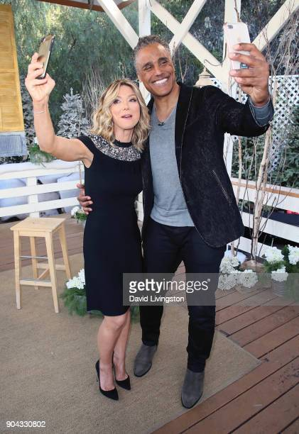 Host Debbie Matenopoulos and actor Rick Fox pose for selfies at Hallmark's 'Home Family' at Universal Studios Hollywood on January 12 2018 in...