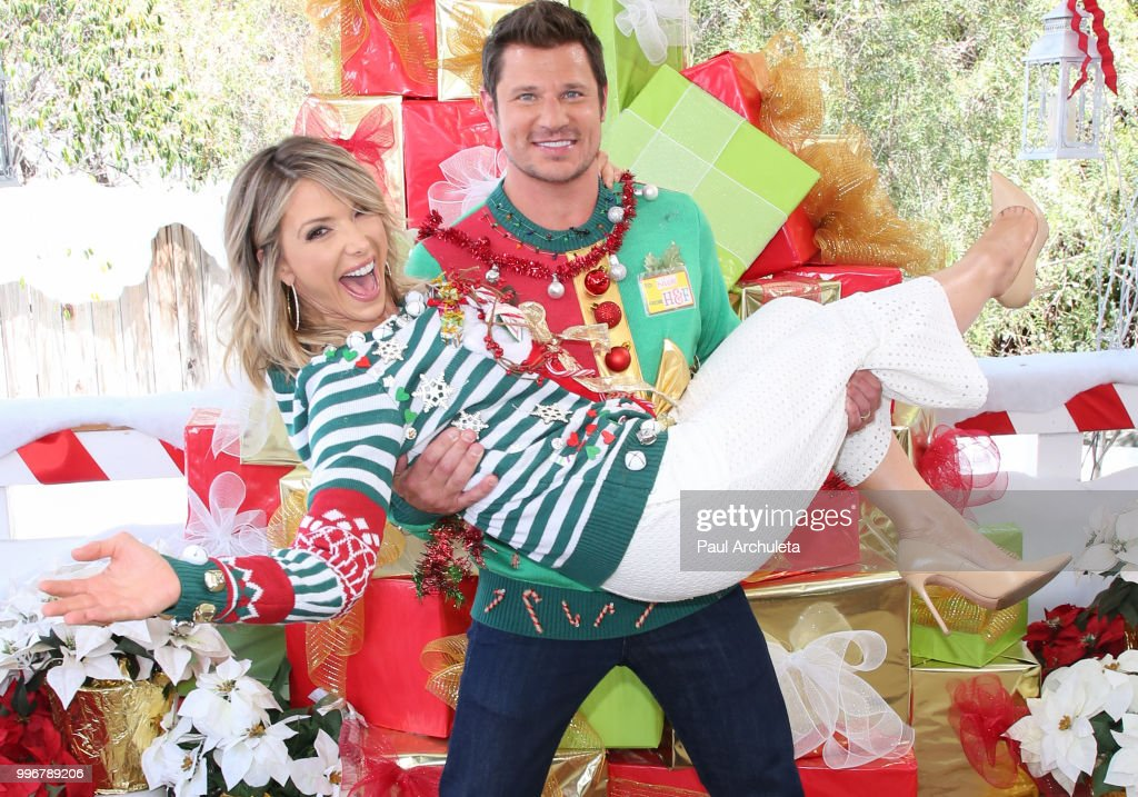 TV Host Debbie Matenopoulos (L) and Actor /Singer Nick Lachey (R) visit Hallmark's 'Home & Family' celebrating 'Christmas In July' with an ugly sweater contest at Universal Studios Hollywood on July 11, 2018 in Universal City, California.