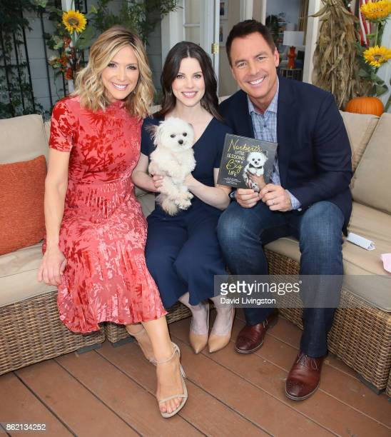 Host Debbie Matenopoulos author Julie Steines and husband/host Mark Steines pose with Norbert at Hallmark's 'Home Family' at Universal Studios...