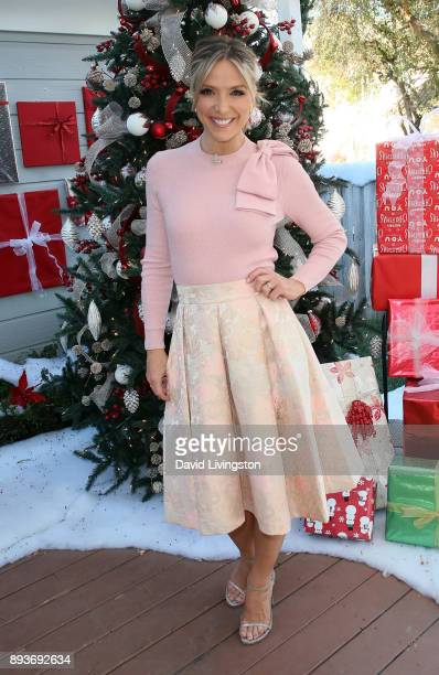 Host Debbie Matenopoulos poses at Hallmark's 'Home Family' at Universal Studios Hollywood on December 15 2017 in Universal City California