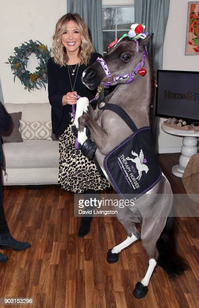 TV host Debbie Matenopoulos poses with a therapy horse at Hallmark's 'Home Family' at Universal Studios Hollywood on January 9 2018 in Universal City...
