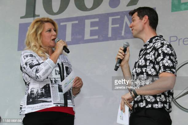 Host Delilah and Adam Daveline from the cast of The Play That Goes Wrong attend 1067 LITE FM's Broadway In Bryant Park on July 11 2019 in New York...