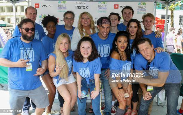 Host Delilah with the cast of Gettin' The Band Back Together attends 1067 LITE FM's Broadway in Bryant Park August 16 2018 in New York City