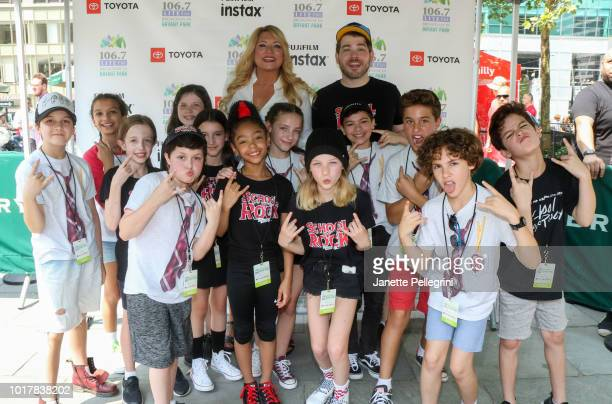 Host Delilah with the cast of School of Rock attends 1067 LITE FM's Broadway in Bryant Park August 16 2018 in New York City