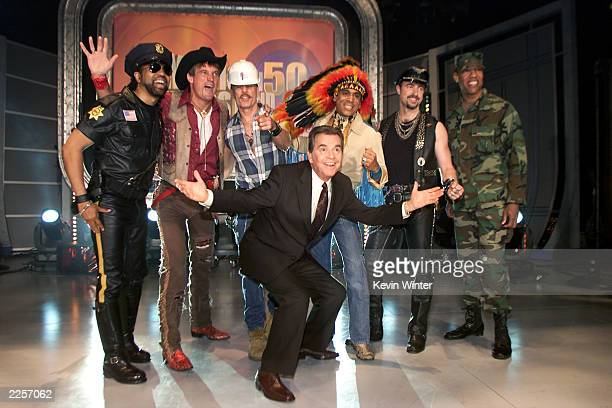 Host Dick Clark with a nonoriginal lineup of disco group Village People at the taping of American Bandstands 50thA Celebration television special...