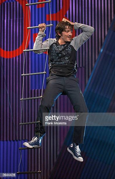 Host Diego Luna hangs from a cable during the MTV Video Music Awards Latin America 2003 at the Jackie Gleason Theater on October 23, 2003 in Miami,...