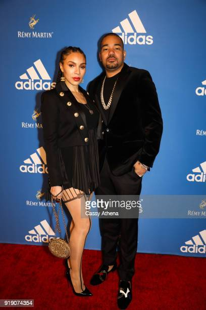 Host DJ Envy and wife Gia Casey pose at the Adidas hosts All Star Black Tie on February 15 2018 in Los Angeles California
