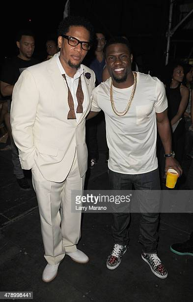 Host DL Hughley and Comedian Kevin Hart attend Day 1 of Jazz In The Gardens at Sun Life Stadium on March 15 2014 in Miami Gardens Florida