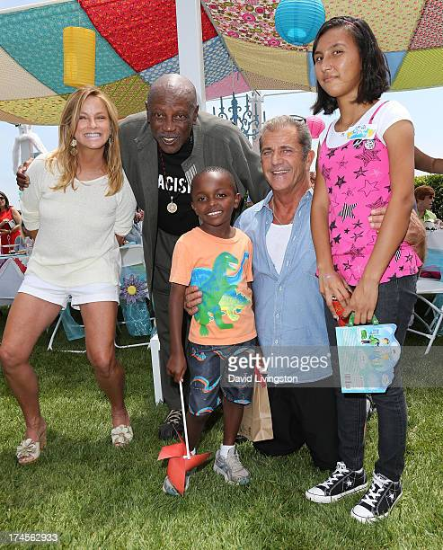 TV host Dorothy Lucey actor Louis Gossett Jr attendee actor Mel Gibson and attendee pose at the Mending Kids International Gala celebrating kids...