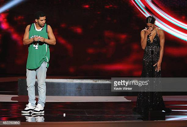 Host Drake and WNBA player Skylar Diggins onstage during the 2014 ESPYS at Nokia Theatre LA Live on July 16 2014 in Los Angeles California