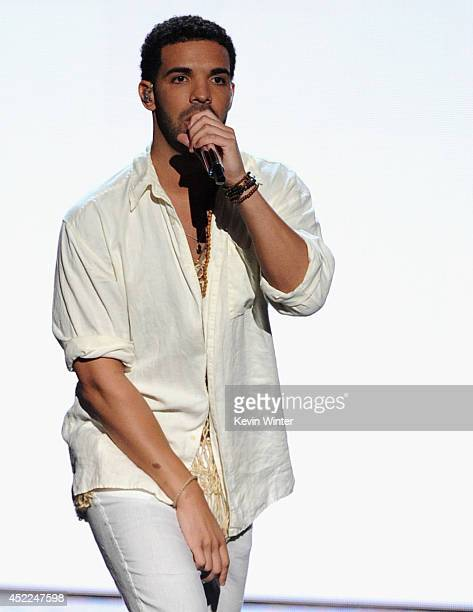 Host Drake performs onstage during the 2014 ESPYS at Nokia Theatre LA Live on July 16 2014 in Los Angeles California