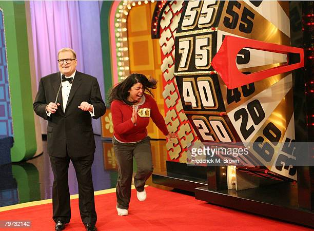 Host Drew Carey and a contestant celebrate during The Price is Right Million Dollar spectacular taping at CBS Television City on February 12 2008 in...