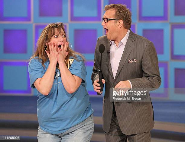 Host Drew Carey and a contestant react during CBS' The Bold and the Beautiful Showcase on The Price Is Right television show on March 12 2012 in Los...
