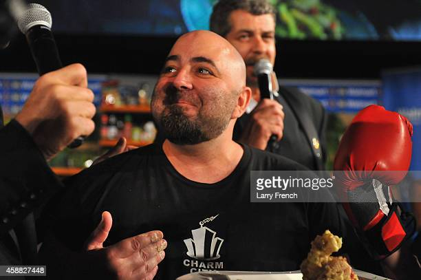 Host Duff Goldman brings out potato chips dish during the DC Central Kitchen's Capital Food Fight event at Ronald Reagan Building on November 11 2014...