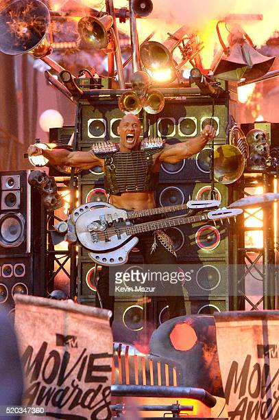 Host Dwayne Johnson performs onstage during the 2016 MTV Movie Awards at Warner Bros Studios on April 9 2016 in Burbank California MTV Movie Awards...