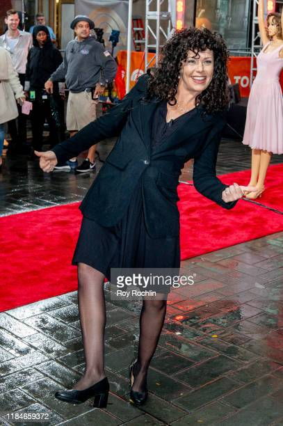 Host Dylan Dreyer dressed as Elaine Benes of Seinfeld during NBC's Today Halloween Celebration at Rockefeller Plaza on October 31 2019 in New York...