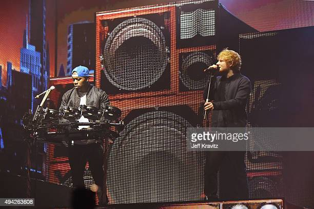 Host Ed Sheeran performs with DJ Locksmith of Rudimental during the MTV EMA's 2015 at the Mediolanum Forum on October 25 2015 in Milan Italy