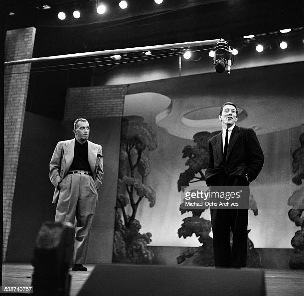 Host Ed Sullivan watches singer Andy Williams perform during the Toast of the Town show hosted by Ed Sullivan at the Maxine Elliott Theater in New...