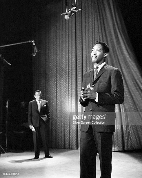 Host Ed Sullivan watches singer Sam Cooke performing on The Ed Sullivan Show, New York City, 1957.