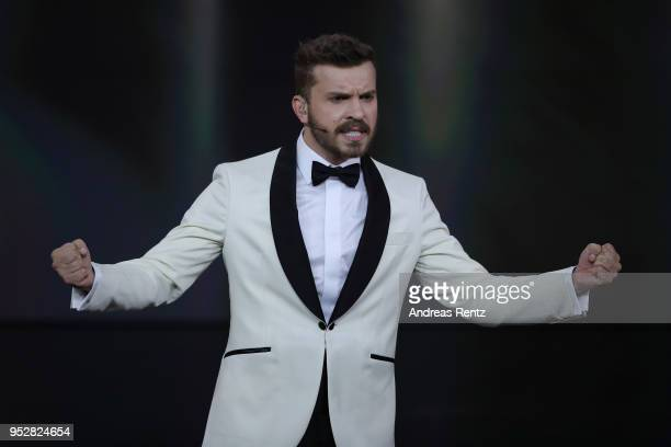 Host Edin Hasanovic performs on stage during the Lola German Film Award show at Messe Berlin on April 27 2018 in Berlin Germany