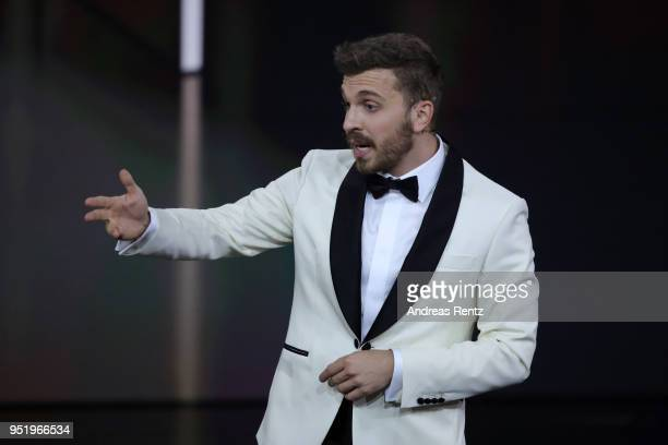 Host Edin Hasanovic speaks on stage during the Lola German Film Award show at Messe Berlin on April 27 2018 in Berlin Germany