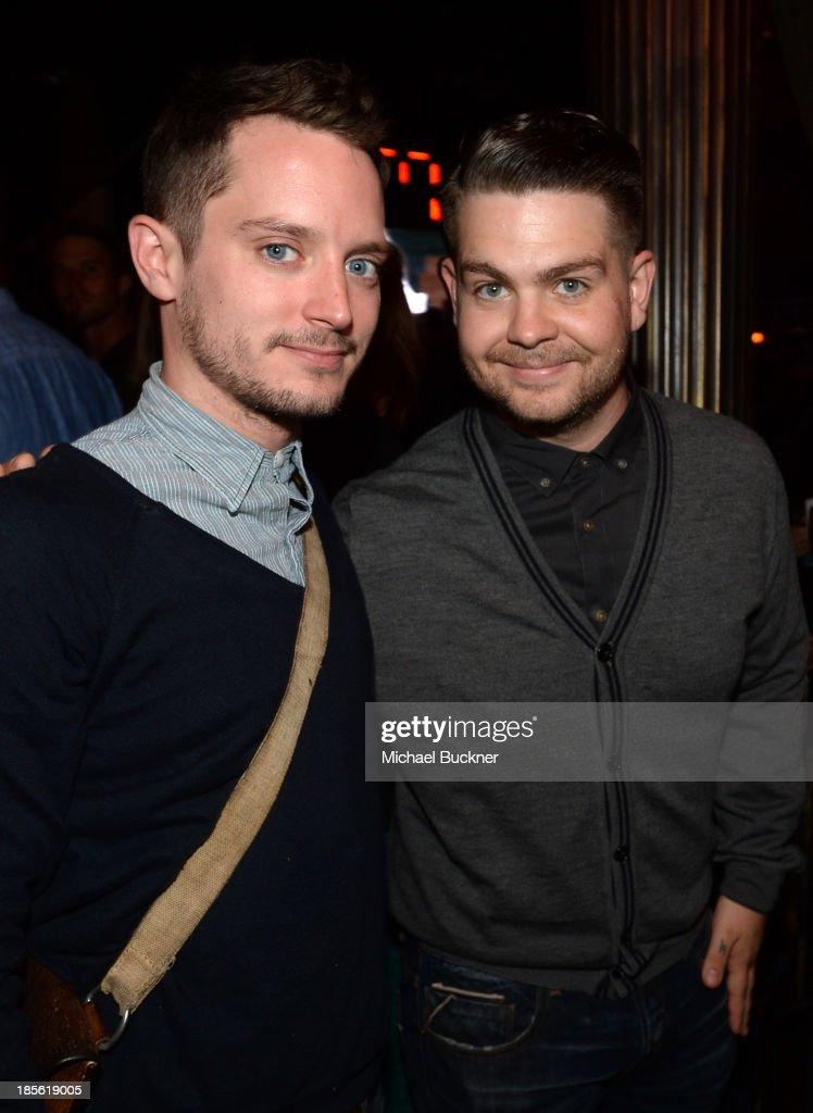 Host Elijah Wood (L) and Fuse News correspondent Jack Osbourne attend the Assasin's Creed IV Black Flag Launch Party at Greystone Manor Supperclub on October 22, 2013 in West Hollywood, California.