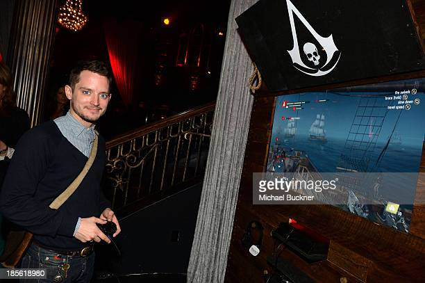 Host Elijah Wood playing the Sony Playstation 4 at the Assasin's Creed IV Black Flag Launch Party at Greystone Manor Supperclub on October 22 2013 in...