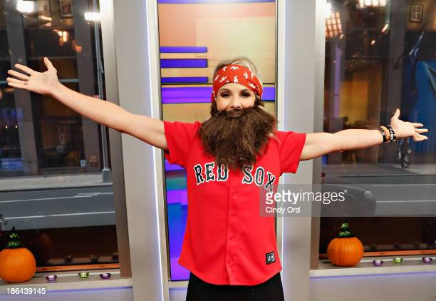 Host Elisabeth Hasselbeck wears a 'Duck Dynasty' costume as FOX Friends celebrates Halloween at FOX Studios on October 31 2013 in New York City