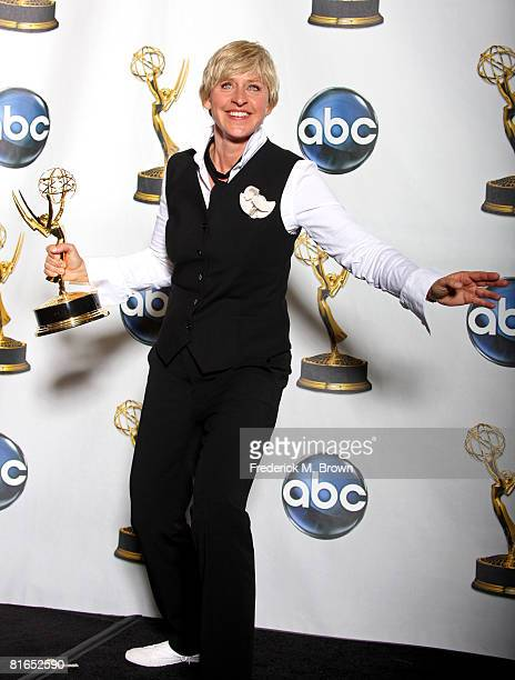 Host Ellen DeGeneres poses with the Outstanding Talk Show Host awad for The Ellen DeGeneres Show in the press room at the 35th Annual Daytime Emmy...