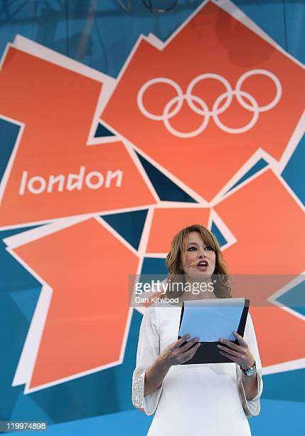 Host Ellie Crisell speaks during the' London 2012 One Year To Go' ceremony in Trafalgar Square on July 27 2011 in London England The one year...