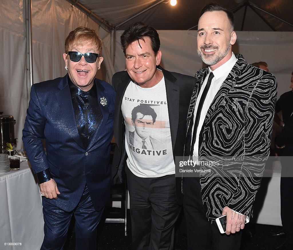 Host Elton John, actor Charlie Sheen and host David Furnish attend Bulgari at the 24th Annual Elton John AIDS Foundation's Oscar Viewing Party at The City of West Hollywood Park on February 28, 2016 in West Hollywood, California.