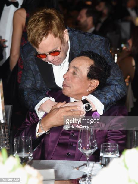 Host Elton John and recording artist Smokey Robinosn attend the 25th Annual Elton John AIDS Foundation's Academy Awards Viewing Party at The City of...