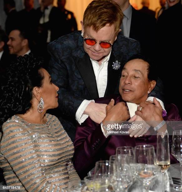 Host Elton John Recording artist Smokey Robinson and Frances Glandney attend the 25th Annual Elton John AIDS Foundation's Academy Awards Viewing...