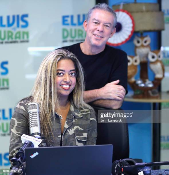 Host Elvis Duran and cohost Medha Gandhi pose as she joins The Elvis Duran Z100 Morning Show at Z100 Studio on September 17 2018 in New York City