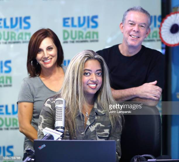 Host Elvis Duran Danielle Monaro and cohost Medha Gandhi pose as she joins The Elvis Duran Z100 Morning Show at Z100 Studio on September 17 2018 in...