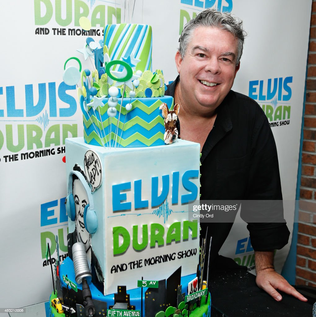 Host Elvis Duran poses with a birthday cake created for him by 'House of Clarendon' as 'The Elvis Duran Z100 Morning Show' celebrate Elvis Duran's 50th Birthday at Z100 Studio on August 5, 2014 in New York City.