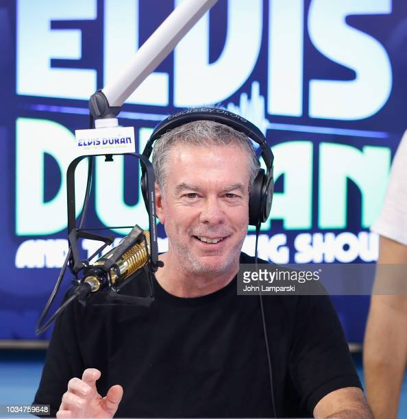 Host Elvis Duran speaks as Cohost Medha Gandhi joins The Elvis Duran Z100 Morning Show at Z100 Studio on September 17 2018 in New York City