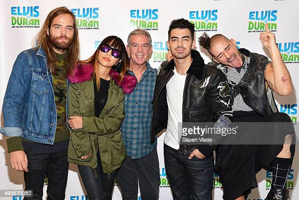 Host Elvis Duran with Jack Lawless JinJoo Lee Joe Jonas and Cole Whittle of DNCE visit The Elvis Duran Z100 Morning Show at Z100 Studio on October 21...