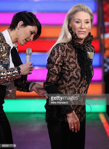 Host Emma Willis helps Angie Best with her microphone as she enters the Celebrity Big Brother House at Elstree Studios on January 3 2017 in...