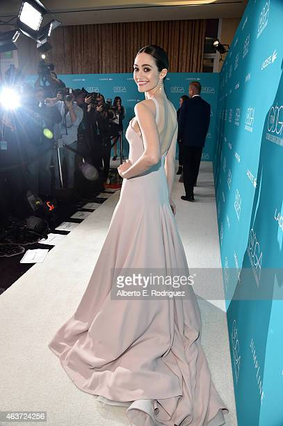 Host Emmy Rossum attends the 17th Costume Designers Guild Awards with presenting sponsor Lacoste at The Beverly Hilton Hotel on February 17 2015 in...
