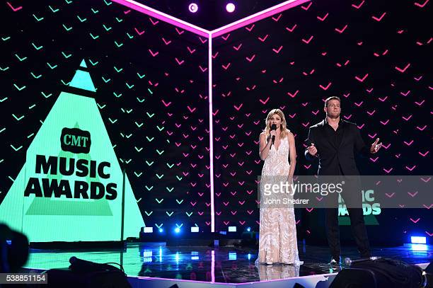 Host Erin Andrews and Co-Host JJ Watt onstage during the 2016 CMT Music awards at the Bridgestone Arena on June 8, 2016 in Nashville, Tennessee.