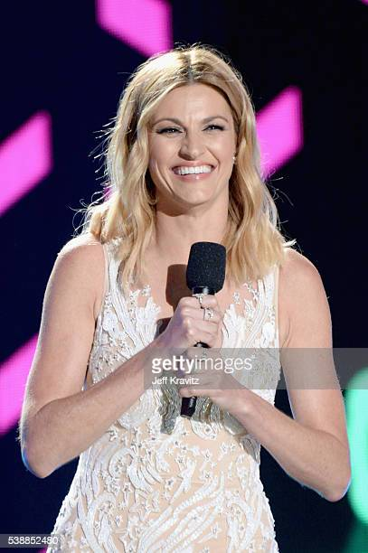 Host Erin Andrews speaks onstage during the 2016 CMT Music awards at the Bridgestone Arena on June 8 2016 in Nashville Tennessee