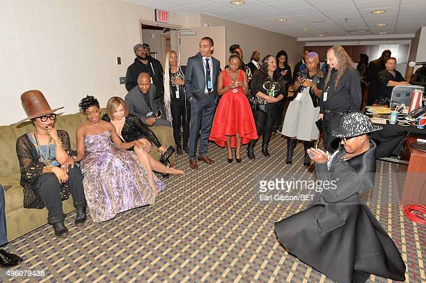 Host Erykah Badu and actresses Tichina Arnold and Tisha CampbellMartin pose for a photo on the sofa backstage at the 2015 Soul Train Music Awards at...
